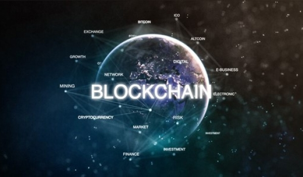 Globe with multiple words used to describe what is blockchain technology. World globe also has the word blockchain across it.