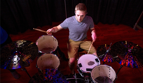 Student playing drums