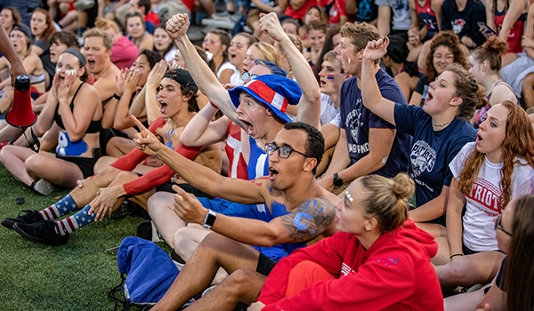 Students cheering at a football game