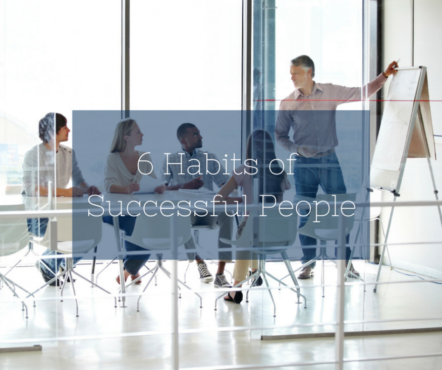 Group of employees collaborating in a conference room.