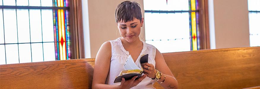 Master's in Christian Studies student reading the bible in chapel at University of the Cumberlands.